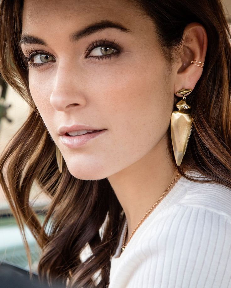 """Bold and daring arrowhead shapes make the Kendra Scott gold Stellar statement earrings the perfect addition to any jewelry-lovers collection. Size: 2.875""""L X 1""""W on post"""