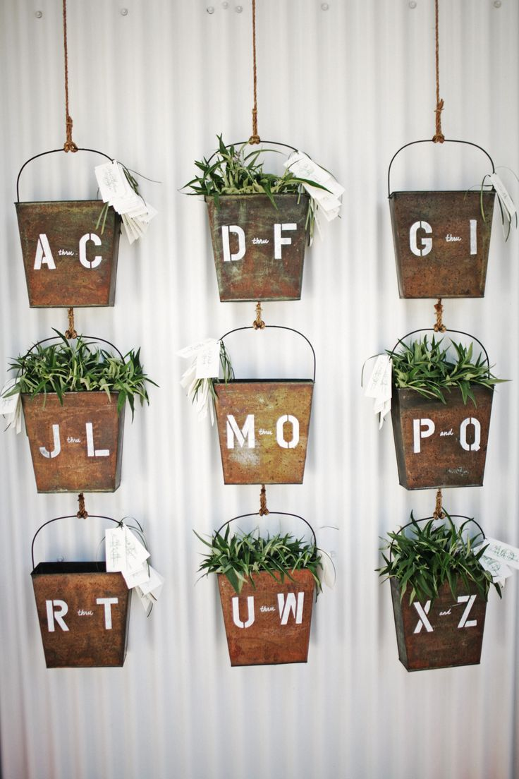 Love this escort card display for a rustic wedding