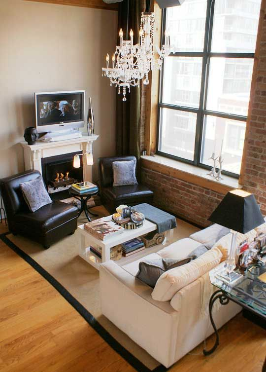 so many elements. chandeliers. silk on brick. leather slipper chairs. lucite lamp base. fire+ice fireplace