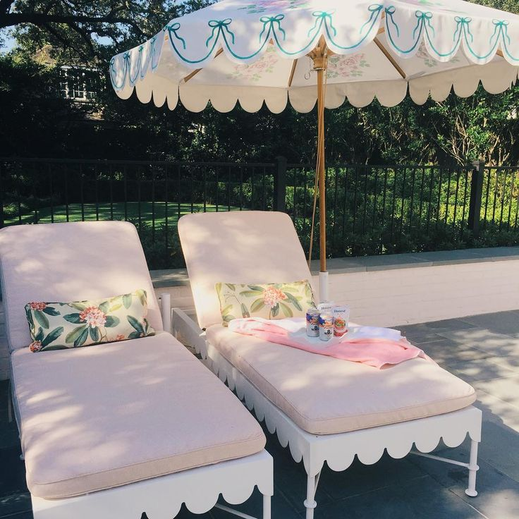 Scalloped loungers + market umbrella via Biscuit Home