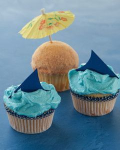Shark and Beach Cupcakes | Martha Stewart Living - Look out for blue paper fins slicing through icing waves on this shark-inspired cupcake.