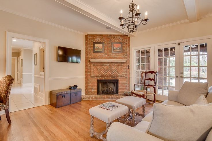 Traditional, inviting, brick fireplace at 8988 Winding Way, Germantown, TN 38139