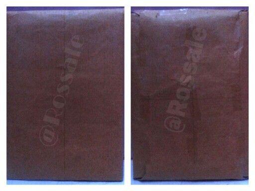 Tampak depan dan belakang dari lapisan akhir barang yang terjual yaitu kertas cokelat