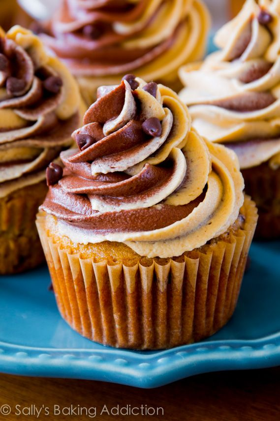 My favorite banana chocolate chip cupcakes frosted with peanut butter and chocolate swirl frosting! Like a peanut butter cup, but better.