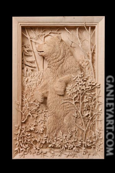 Dave Ganley woodworking... Grizzly bear in brush with small leaves: very detailed and intricate wood carving done all by hand.