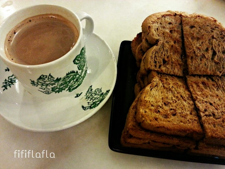 Malaysian style breakfast. Hot Milo with brown bread toasy. Just butter and kaya.