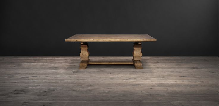 A really warm and welcoming chunky dining table in reclaimed timber, with the option of a sleek marble top. Daringly distinctive furniture by Timothy Oulton.