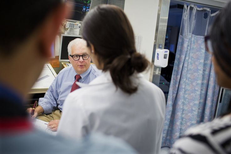 Dr. Allan Ropper speaks with residents and fellows as they do rounds at the neuroscience intensive care unit at Brigham and Women's Hospital in Boston, Massachusetts.