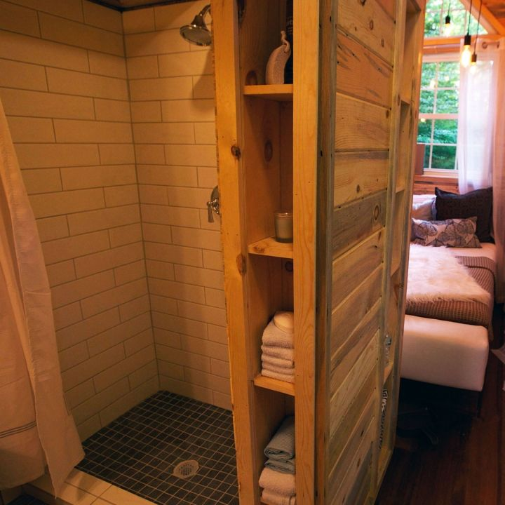 tiny house nation....towel storage and tiny shower                              …
