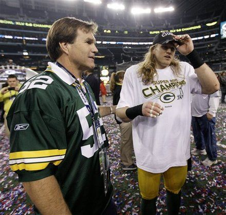 Clay Matthews, right, is congratulated by his father Clay Matthews Jr