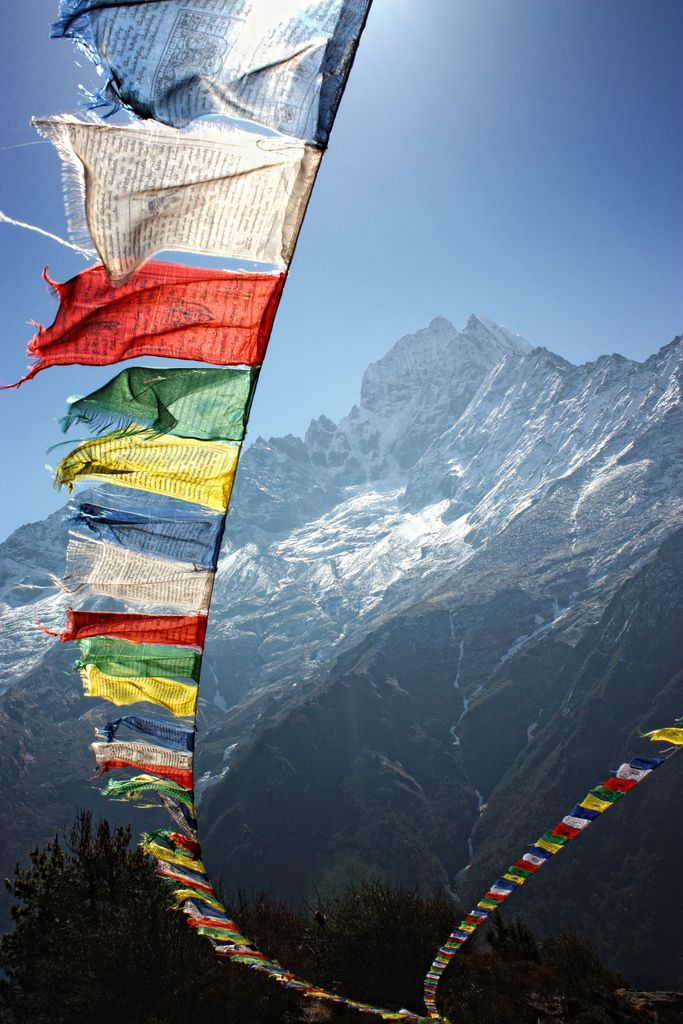 A prayer flag is a colorful rectangular cloth, often found strung along mountain ridges and peaks high in the Himalayas. They are used to bless the surrounding countryside and for other purposes. Prayer flags are believed to have originated with Bon, which predated Buddhism in Tibet. In Bon, shamanistic Bonpo used primary-colored plain flags in healing ceremonies in Nepal. They are unknown in other branches of Buddhism.  Traditional prayer flags include woodblock-printed text and images
