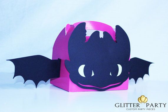 Adorable party favors that will be sure to make a hit! You wont find anything like these unique and custom How To Train Your Dragon themed party favor boxes with Toothless The Dragon! Each box features Toothless face and wings with glitter green eyes! Other box colors are available. This listing is for 12 pink boxes Each boxes measures 6 1/4 x 6 They are shipped flat and you will need to fold out the wings when they arrive.  *THIS ITEM SHIPS PRIORITY 2 DAY  The boxes also come in RED…