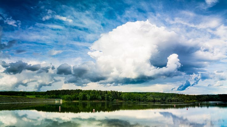 Clouds over the Lake - Panorama image of a large cloud formation over the lake.