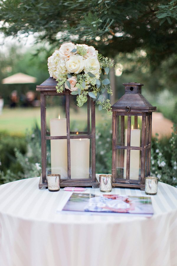 lantern wedding decor, photo by Pinkerton Photography http://ruffledblog.com/casual-glam-wedding-in-paradise-valley #weddingideas