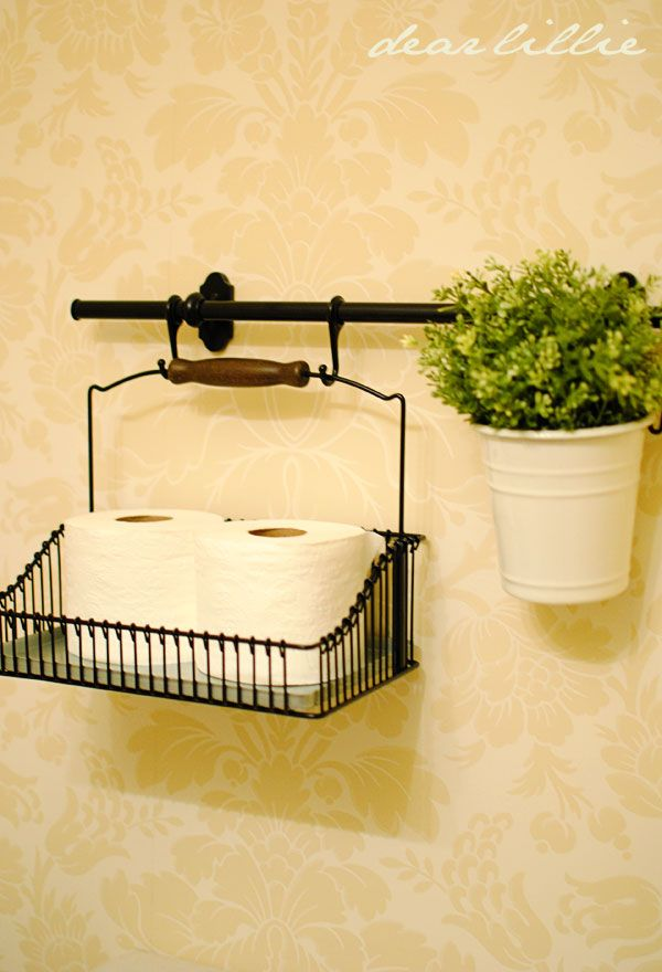 Classic and stylish way to store spare rolls of TP (Also, so your guests won't have to rummage under your powder room sink!) Plus additional ways to use this basket and pot from - wait for it - IKEA!! Who knew?