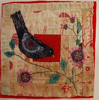 Quilt block with appliqued bird and flowers. So pretty. Found at Thread and Thrift.