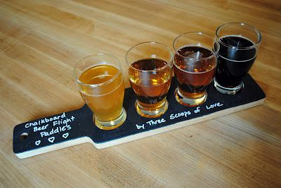 Good idea for a beer-tasting party - set the tasting glasses on a wood slab painted with chalkboard paint