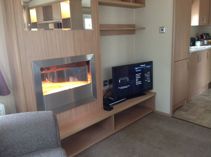 lovely cosy lounge with flatscreen TV, DVD player and a contemporary fire surround  inside the Ashmore plus D28. @Parkdean Page Page Sandford Holiday park #britishholiday #homeoraway