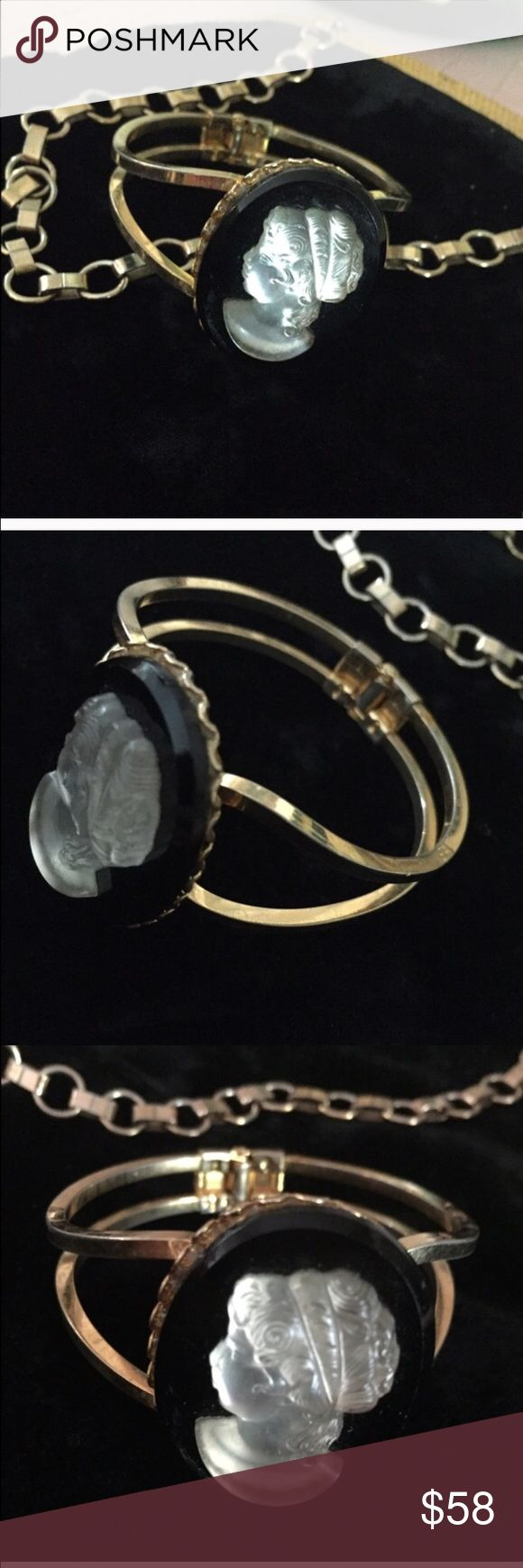 """VTG Black & Frosted Glass Cameo Bracelet Beautiful Vintage retro Clamper Cuff BRACELET with a Frosted Glass Cameo on top of a black resin disc on a gold-tone clamper bracelet. SPRING LOADED HINGE. Hidden front opening SPREADS APART to place on your wrist. Inside diameter measures 6-1/2"""", so if you measure your wrist you can compare for fit. Cameo measures 1-3/4"""" x 1-1/4"""". No maker's mark. In excellent preowned vintage condition! Vintage Jewelry Bracelets"""