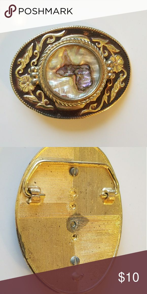 Belt buckle Western style Belt buckle, never worn! Pretty detail with pearl like center. Able to be used on any belt with connections. Ask me about bundling! other Accessories Belts