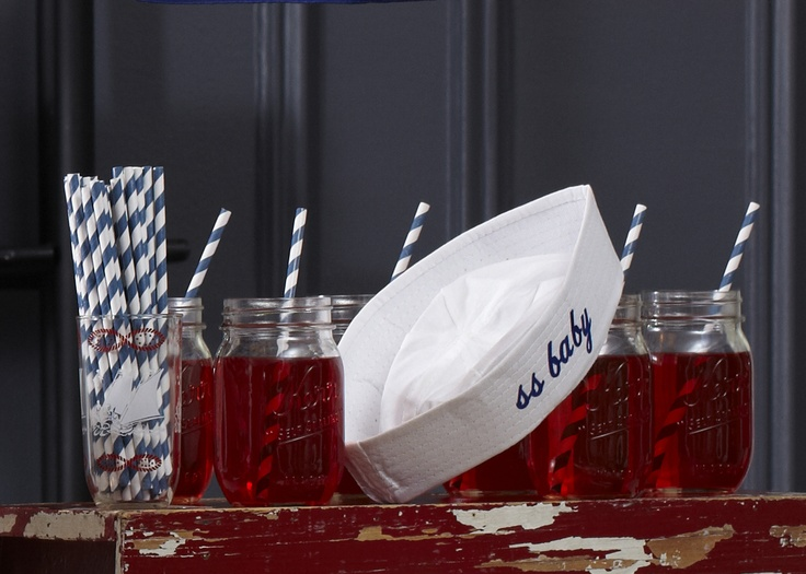Pirate Punch. Blue-striped straws plunge into the nautical baby shower theme—and these vintage mason jars.