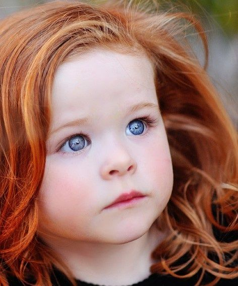 Red - this is a much prettier version of me as a child. Red hair, blue eyes. Now I can't find that color in a bottle....