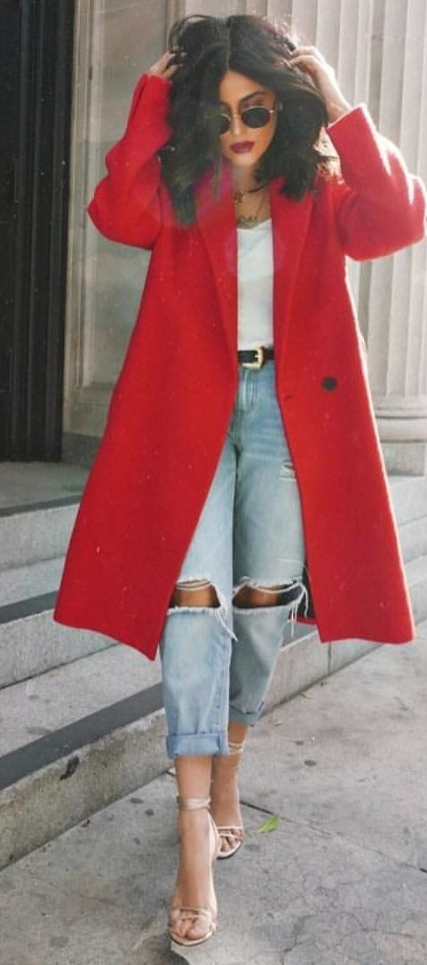 #spring #outfits woman in red coat and distressed blue denim jeans. Pic by @zara__europe