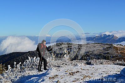 Great Fatra (Velká Fatra) mountain in Slovakia in early winter. View from the mountains ridge - sunny day with a touch of snow. A woman goes up to a peak.