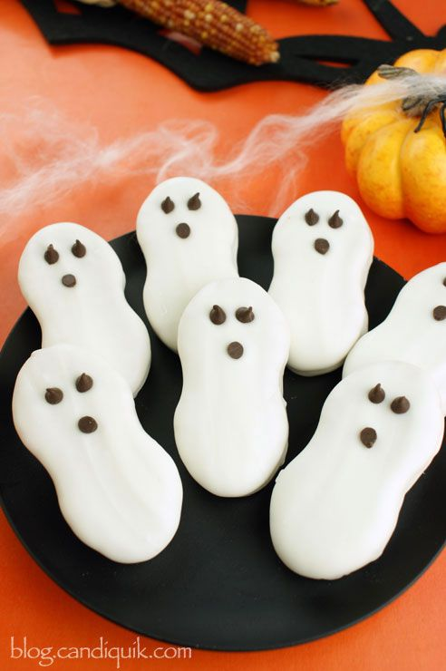 Halloween Ghost Cookies using Nutter Butters - plus a video tutorial showing how to dip them perfectly!