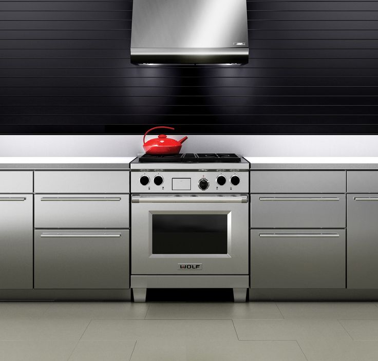 """The Wolf 30"""" dual fuel range is the best of two worlds. Topside: Wolf gas cooking in all its glory, with the power and control of dual-stacked burners. Below: that marvel of cooking technology, the Wolf dual convection electric oven. Two fans, four heating elements, and 10 cooking modes to ensure delicious results. #dualfuel #range"""