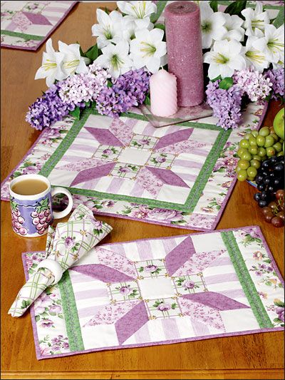 Emily's Roses Kitchen Set Quilting Pattern Download from e-PatternsCentral.com -- A pretty rose print makes a beautiful runner and place mat set for your kitchen.