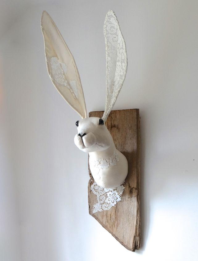 Large white textile hare trophy with lace. Faux taxidermy animal head sculpture.