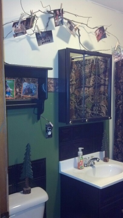 This is the boys bathroom, decked out with camo & hunting pics.