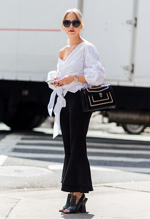 You can't go wrong with a white shirt, especially when it's as souped-up as this asymmetric number. Go full on monochrome and add black flared trousers, structured slingbacks and a gorge shoulder bag for work wins