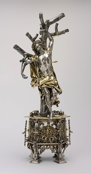 A silver, gilt, glass, pearl, sapphire and ruby reliquary of St Sebastian, probably made in Augsburg, Germany, in 1497; the saint is shown pierced by arrows, his symbolic attributes. (Victoria & Albert Museum)