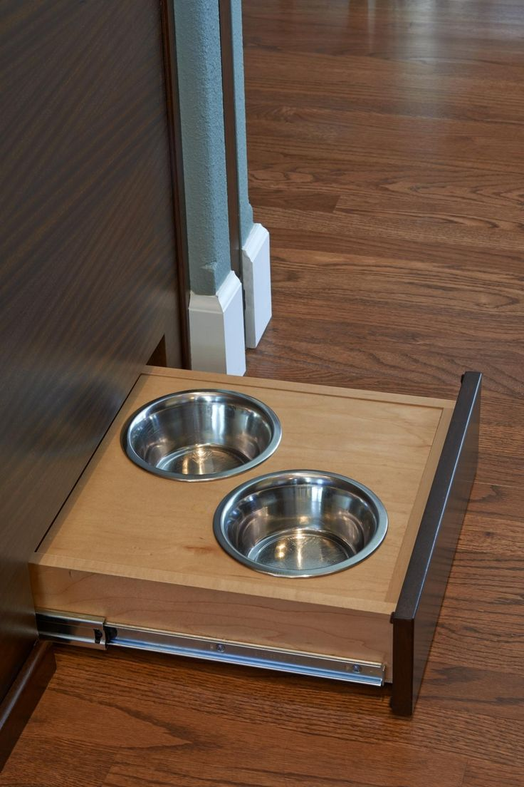 A pair of bowls can be pulled out from beneath the kitchen island when it's Fido's feeding time, and pushed in when not in use.