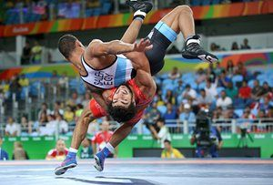 Migran Arutyunyan of Armenia and Egypt's Adham Ahmed Saleh Ibrahim Kahk compete in the quarter-final of the men's greco-roman wrestling. Photograph: Toru Hanai/