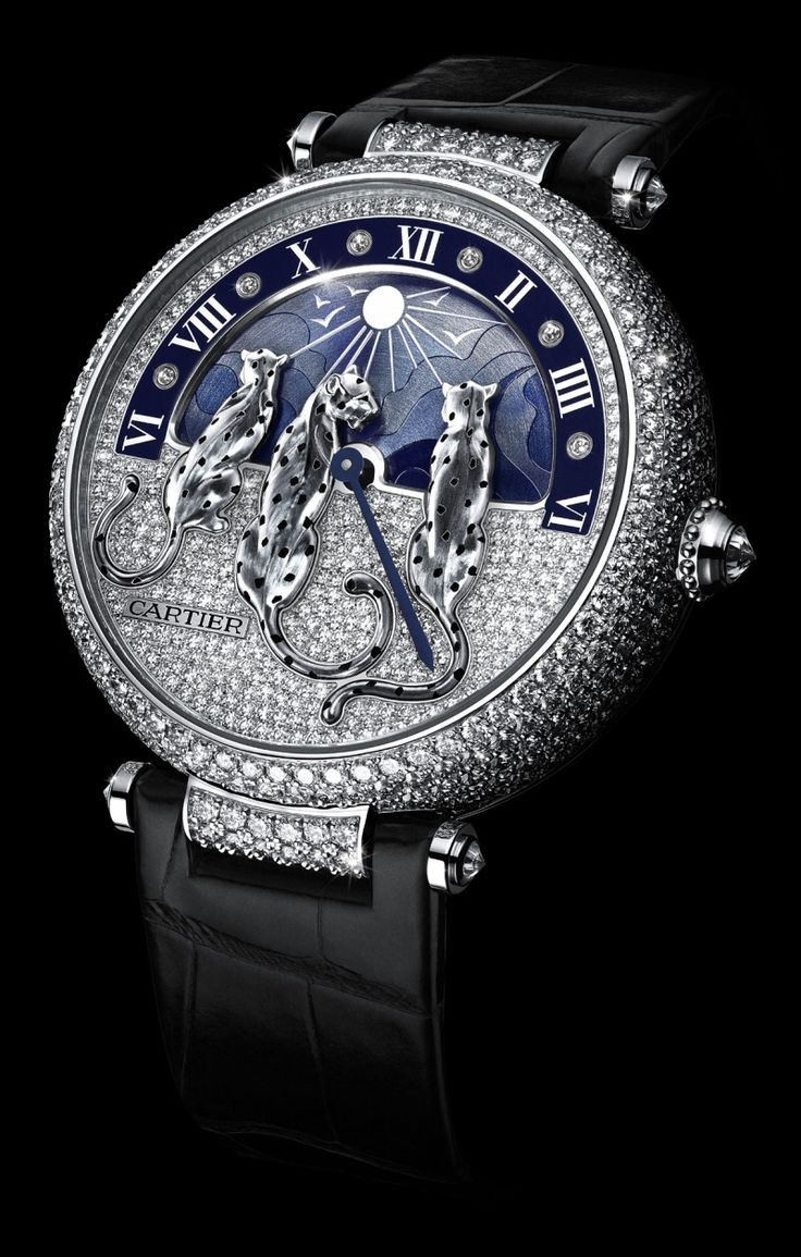PRE-SIHH 2015: Cartier Rêves de Panthères watch with a rotating dial depicts a sky as it transforms from starry night to bright shining canopy. For the first time ever, the panther, a timeless icon of the Maison, appears in a pack.