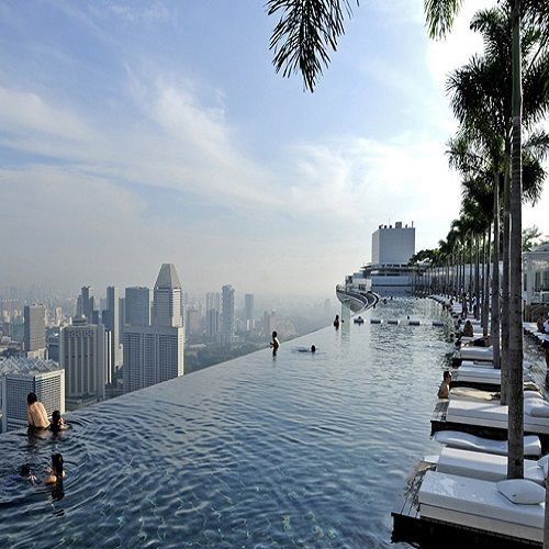 MARINA BAY SANDS, SKYPARK, SINGAPORE - Singapore's Marina Bay Sands holds the reputation for being the most lavish and spectacular hotel in the country. Containing a shopping center, museum and world class restaurants, it's easy to see why. One of its wonders is the SkyPark pool, which is above 57 stories above ground and stretches over 150 metres. Guests can get a birds-eye view of Singapore while cooling off in the pool.