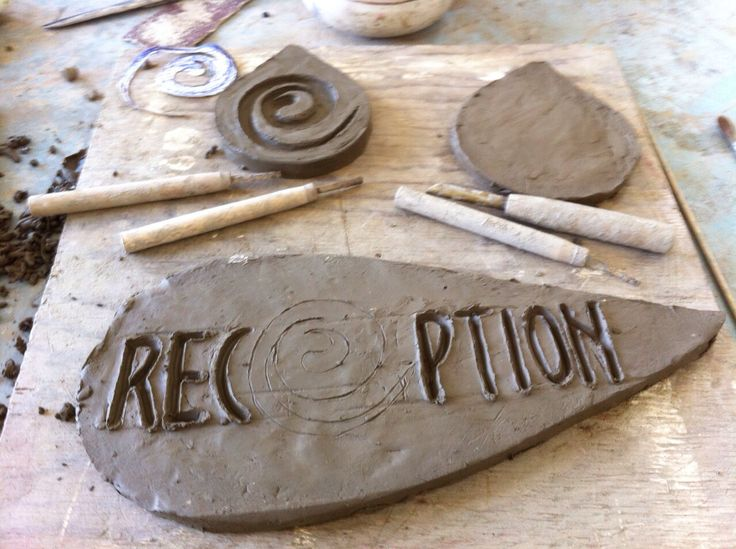 first phase (after drowing and giving shape to the clay) draw the logo.
