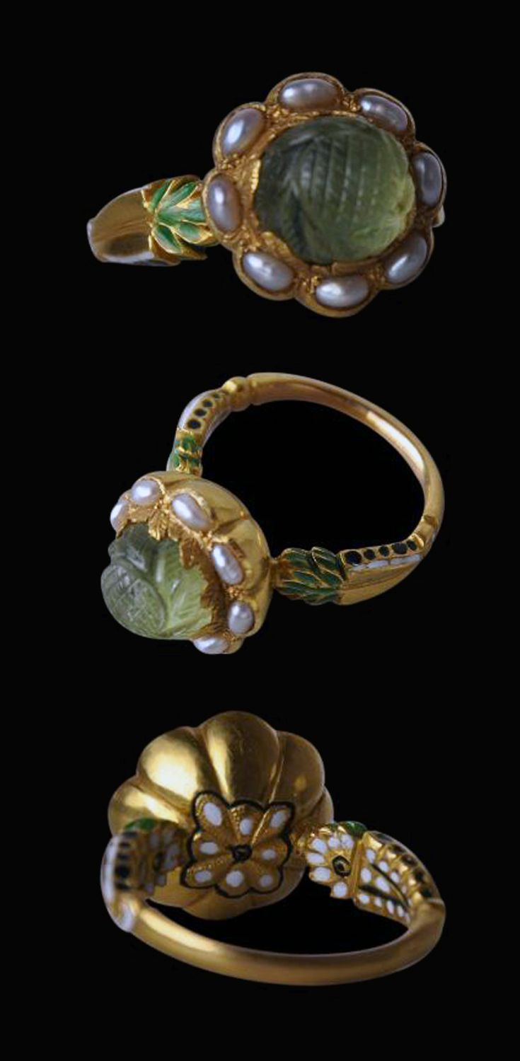 North India | Carved emerald, pearl, enamel and 18k gold ring | 19th century | The Mughal emperors and other Indian princely families had a genuine passion for precious stones and pearls. And among the stones most prized were  emeralds, particularly carved emeralds. | Sold.