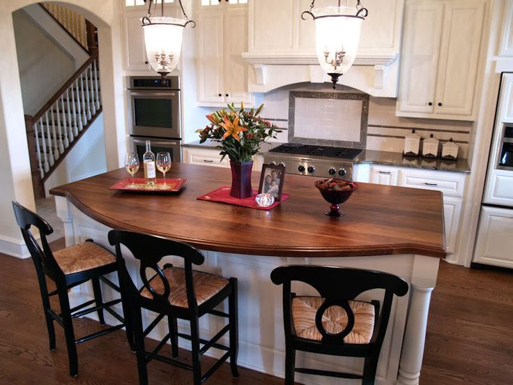wood countertop - love the shape of the island!