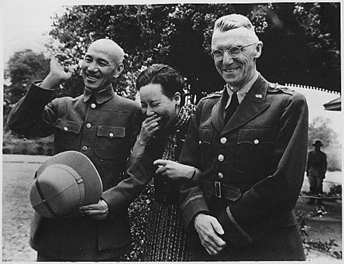 Generalissimo and Madame Chiang Kai Shek and Lieutenant General Joseph W. Stilwell, Commanding General, China Expeditionary Forces, on the day following Japanese bombing attack [Doolittle Raid]. Maymyo, Burma 4/19/1942 Records of the Office of the Chief Signal Officer National Archives Identifier: 531135