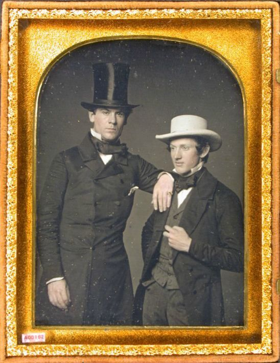 ca. 1850's - Daguerreotype portrait of two gentlemen; one assertively leaning on the shorter of the two.