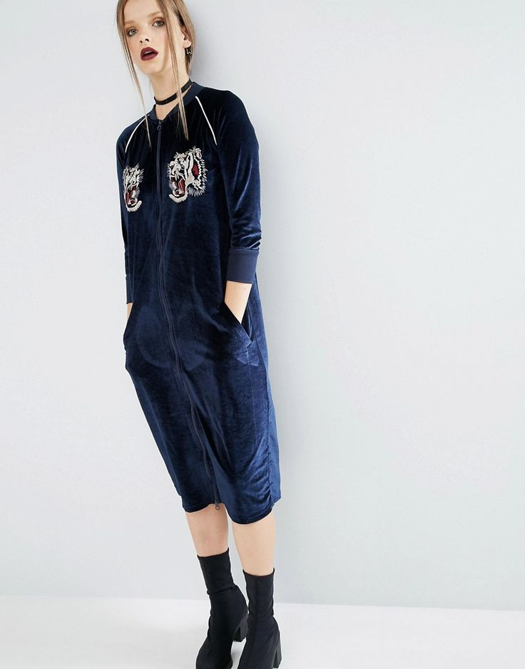 Buy it now. ASOS Velvet Bomber Dress with Tiger Embroidery - Navy. Dress by ASOS Collection, Soft-touch velvet, Baseball collar, Zip fastening, Embroidered detail, Functional pockets, Ribbed cuffs, Regular fit - true to size, Machine wash, 70% Polyester, 20% Polyamide, 10% Elastane, Our model wears a UK 8/EU 36/US 4 and is 173cm/5'8 tall. ABOUT ASOS COLLECTION Score a wardrobe win no matter the dress code with our ASOS Collection own-label collection. From polished prom to the after party…