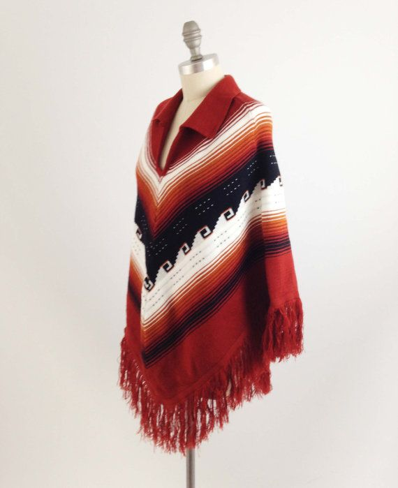 Perfectly Placed Chevron Stripes on a Pretty Poncho  Made of a medium weight knit that boasts diagonal stripes of white, black, brown and rusty