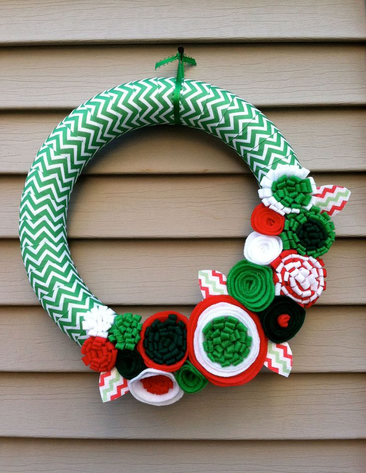 Christmas Wreath wrapped in Chevron Christmas Ribbon decorated with felt flowers. Great for the Holidays. Holiday Wreath.. $42.00, via Etsy.