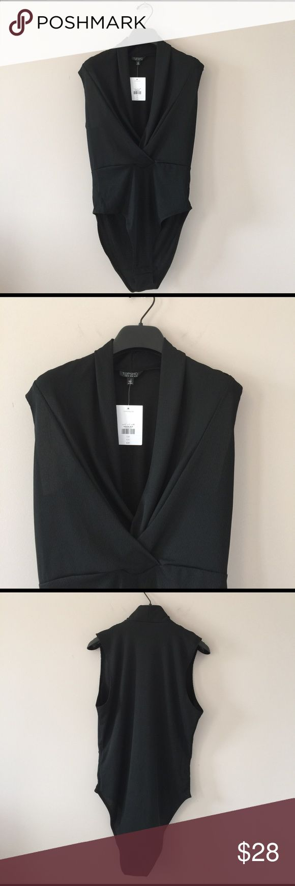 TopShop top NWT! Soft with 96% polyester 4% elastane in body suit style . Very sexy neckline. Short sleeves. Please check pictures, ask questions if needed. Firm! TopShop Tops Blouses