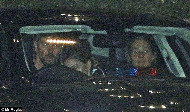 Quick getaway? Madonna was  seen sitting in the back of a car fitted with blue and red lights on the dashboard  after her two concerts at London's O2 this week