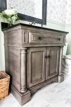 A vanity gets a weathered gray wood look using just chalk paint and wax. Looks so much like real weathered wood in less time with less mess!